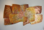 Constellations in Motion, 40 x 72 x 4, copper oxide gold and copper leaf by Thomas Markusen at a Scottsdale art gallery