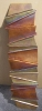 Wall Ribbon, 34 x 9, copper sculpture by Thomas Markusen for a Scottsdale art gallery
